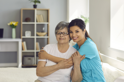 caregiver hugging her patient