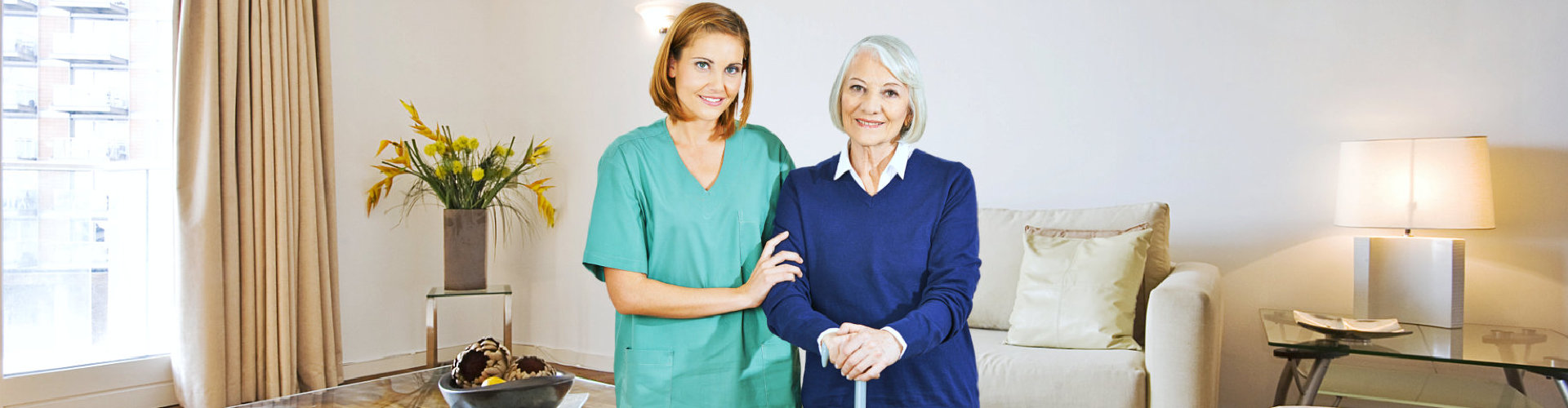 caregiver and senior woman standing